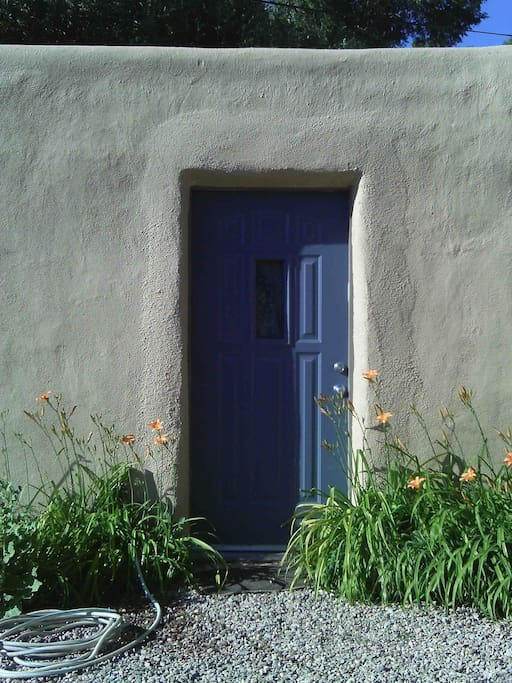 Your own front door with day lilles and hollyhocks in the summer.
