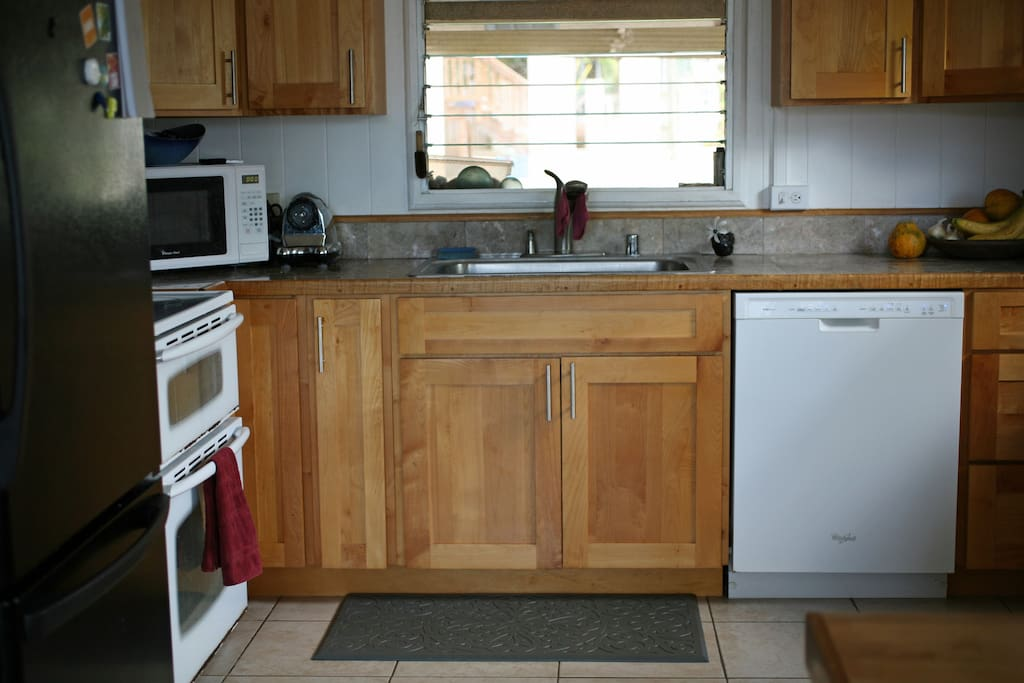 Well-equipped kitchen includes a dishwasher, kitchenaid, vitamix blender, and a double oven.