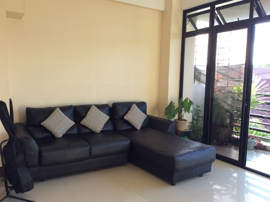 Relaxing in spacious living room adjacent to terrace