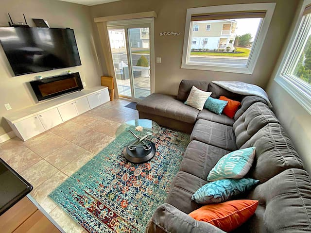 Pull out sectional chaise lounge sofa w/ full bed. Comforter, sheets and pillows provided. Roku with Hulu & Disney+ Electric Fire Place w/ remote and expandable coffee table to optimize space.