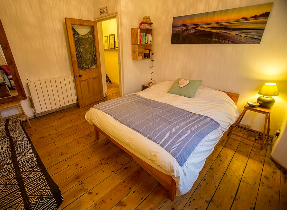 Bright airy bedroom with a king size bed  with drawers and hanging space available