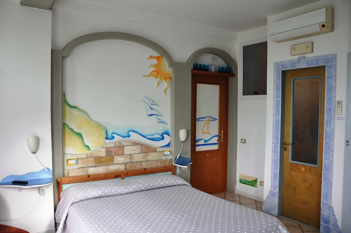 The art of a Crazy Artist Luigi, many details and comfort, just at Casa Mazzola Sorrento apartment