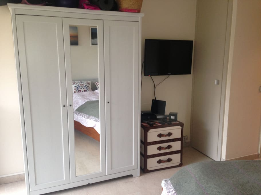 Numerous cupboards, flat screen TV with Apple TV & DVD.