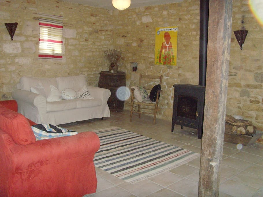 The ground floor room – spacey but cosy with a wood–burning stove