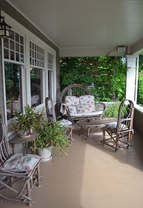 Enjoy a glass of wine on the front porch.