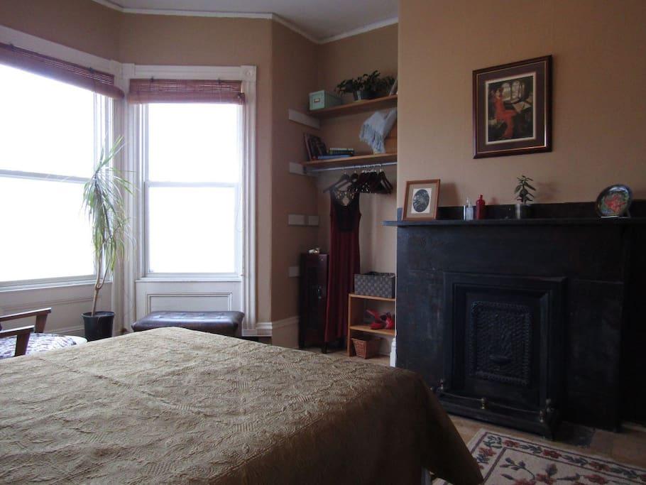 Bedroom-showing fireplace, bay window