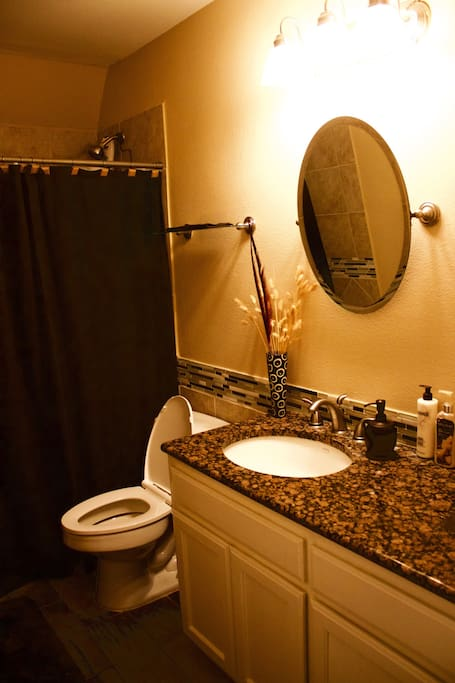 Private guest bathroom fully stocked