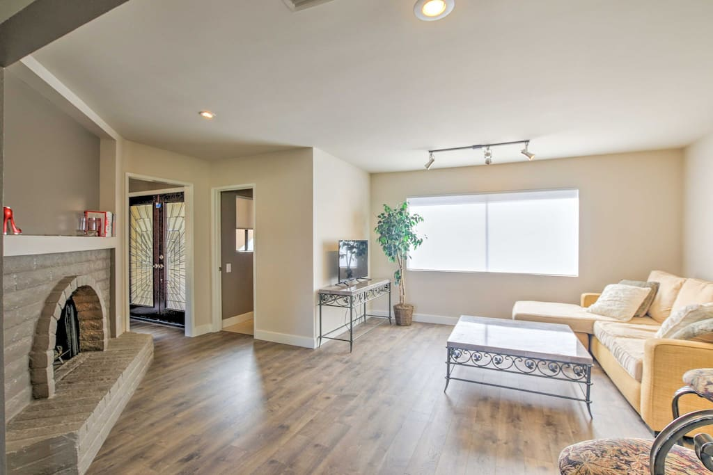 Boasting a gas fireplace, pool, and waterfall shower, this newly renovated home is ideal for those looking for some R&R.