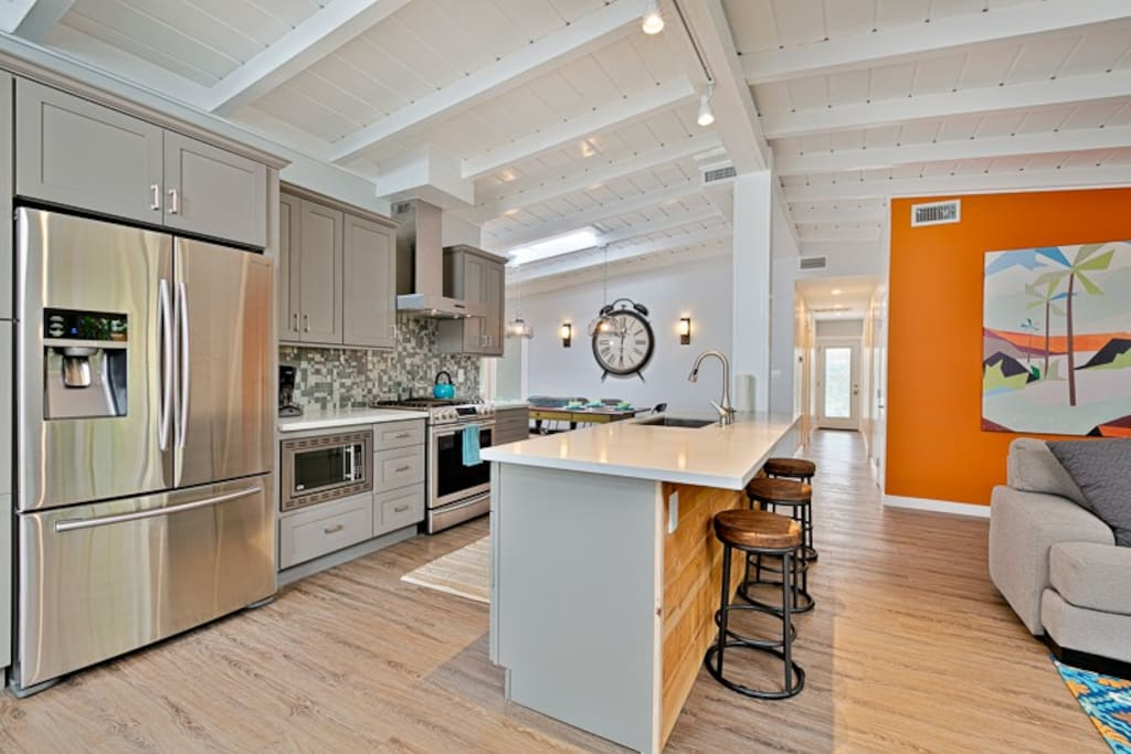 Modern Kitchen with stainless steel appliances and a breakfast bar for 3.