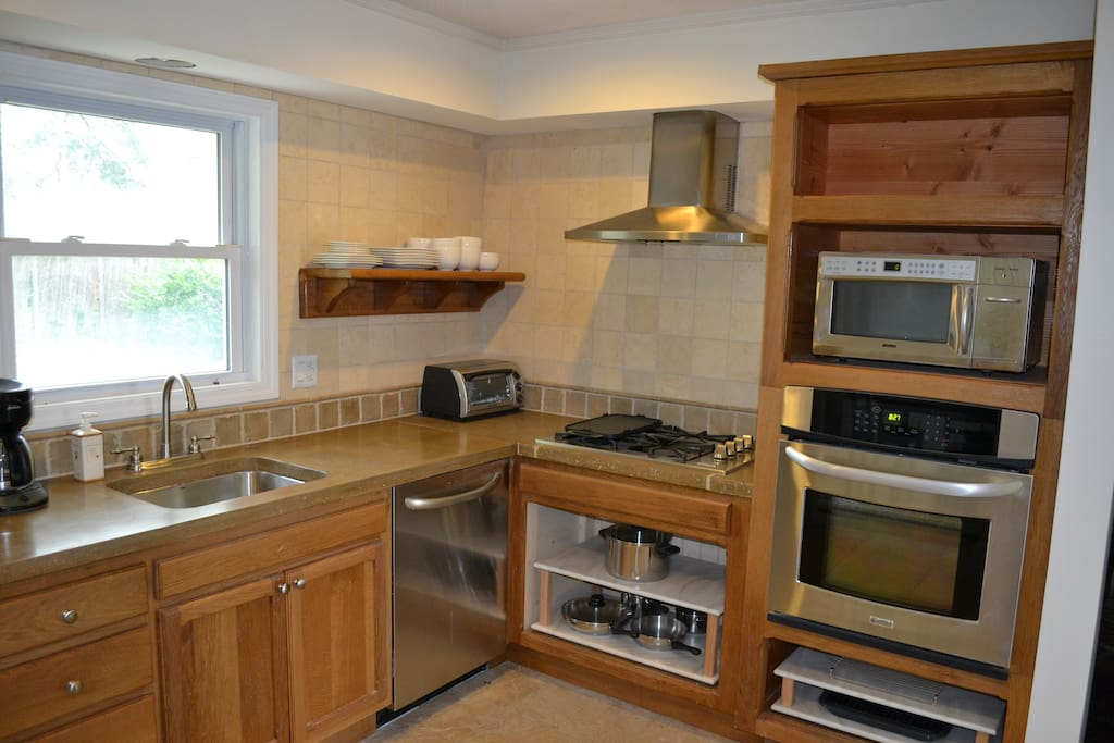 Custom made cabinets with concrete countertop
