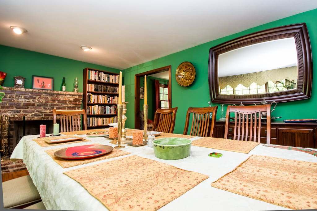 Dining room also doubles as a library.  A large brick fireplace anchors this great room.
