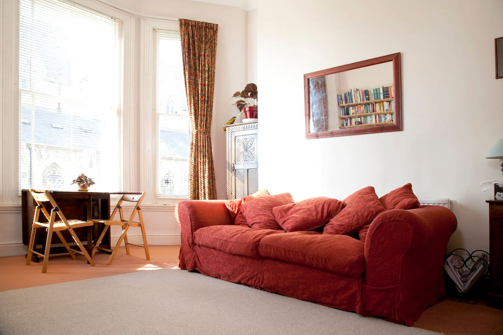 Living area includes this huge, very comfy sofa, additional guest wardrobe and dining table and chairs.