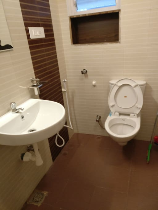 Clean toilets with an attached shower space because hygiene comes first!
