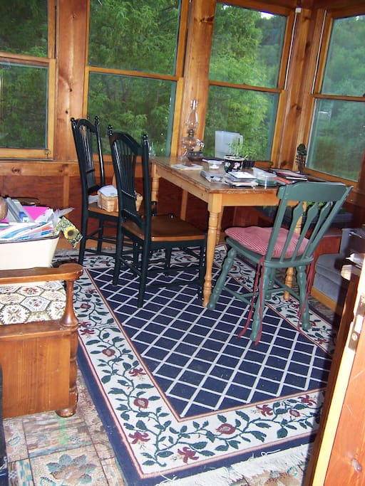 Enclosed 3 season porch for dining, games and conversation.