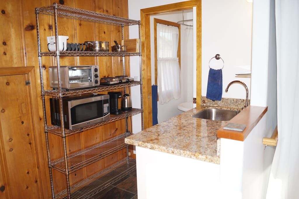 Brand new granite countertop, stainless steel sink, slate tile, and handy appliances make your stay simple and easy.