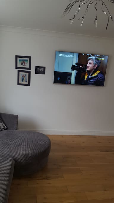 other side of living room with large tv internet and netflix