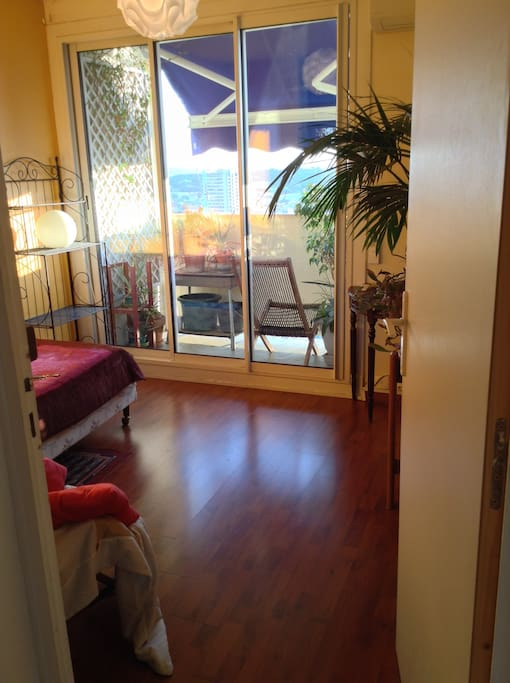your sunny bedroom and balcony; view from the corridor