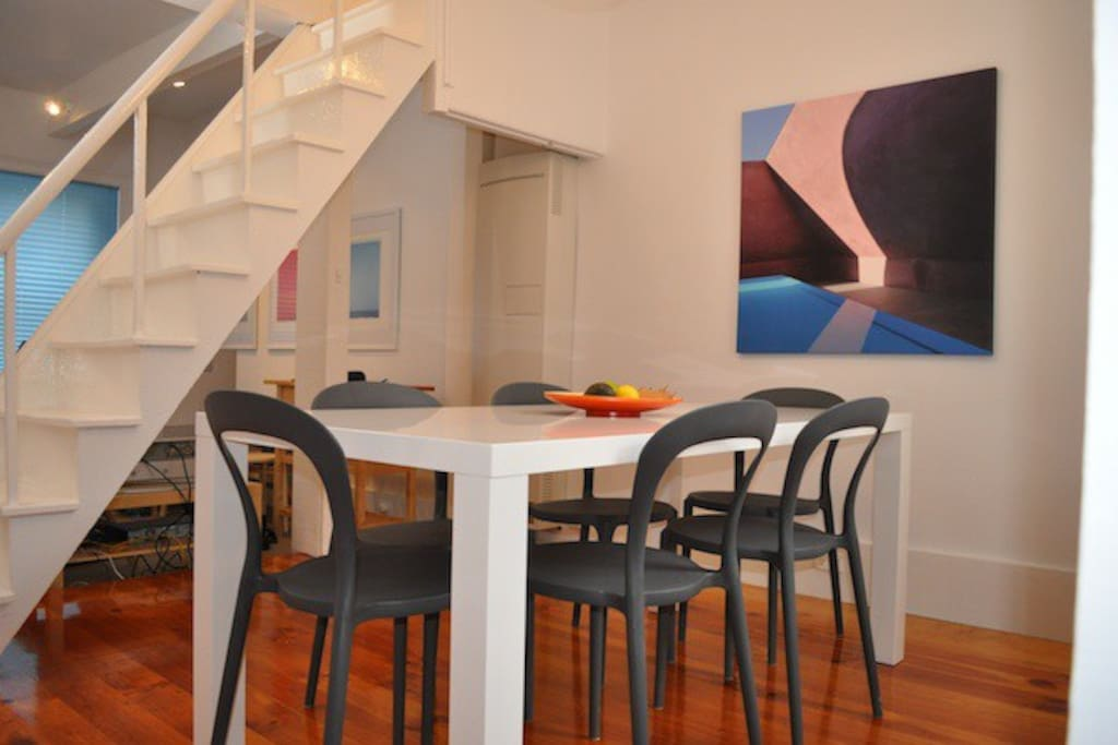 The staircase divides the living and dining rooms.