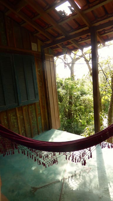 The balcony with a hammock and mountain view