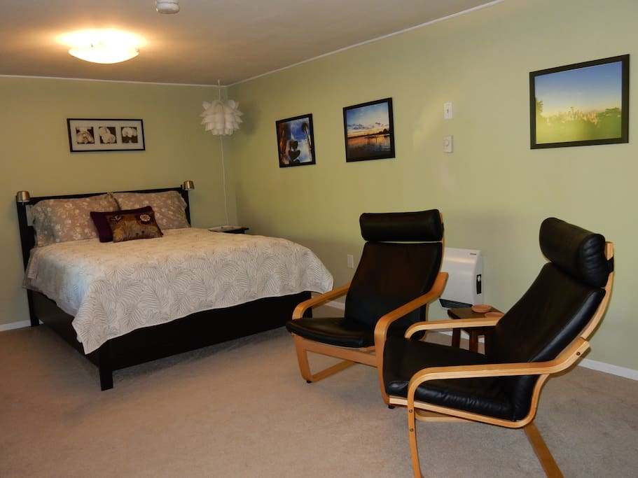 "Room 1 - Queen bed and chairs. ""The bed is large and VERY comfortable"" - Kat"