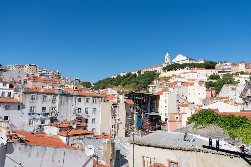 Beautiful view from the window: charming old Lisbon, Graça belvedere at the top