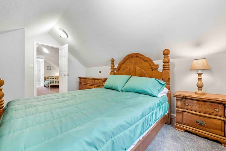 Sturdy and soothing classic wood bedroom with a big closet to house your favorite wardrobes.