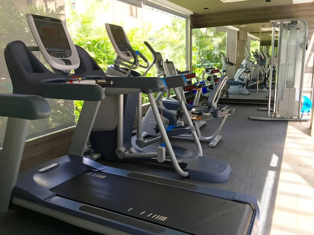 Common area / Gym room with brand new treadmills, weights, cycling and elliptical machines.