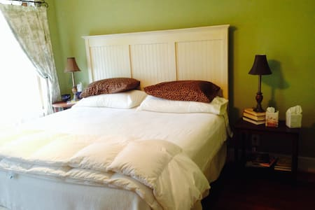 This is a private room and bath in our two story B&B home. King bed, tub/shower, large windows with a great view. Full breakfast included usually served at 8:30. Small guest fridge on landing/loft to be shared with other guests. Quiet, peaceful.