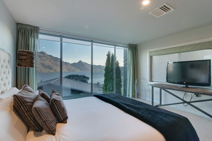 Master bedroom and ensuite with incredible lake views right from your bed.