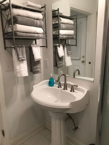 Vanity sink with towels for your use.