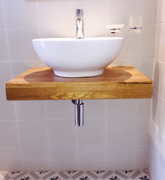 Bespoke oak bathroom shelf with luxury fittings