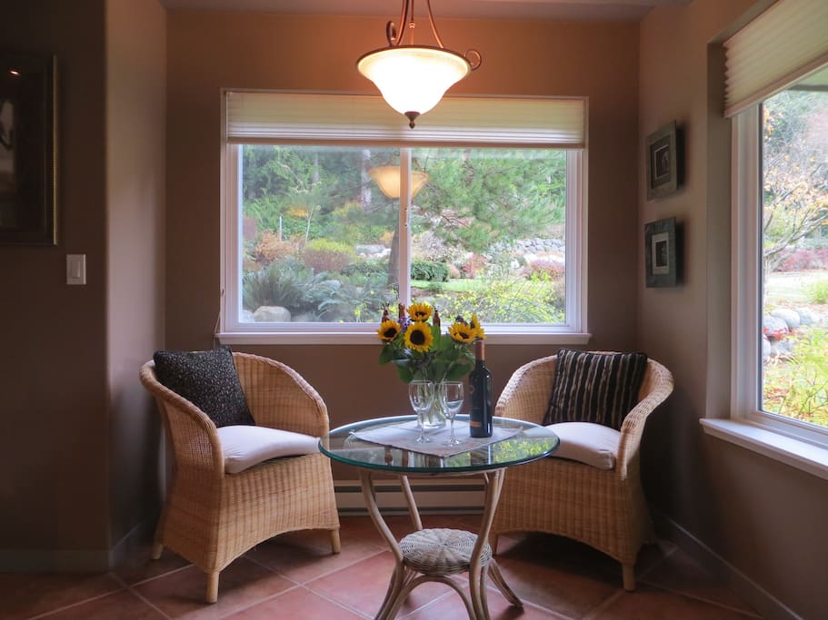 Cozy seating for two with views of the gardens and forest...