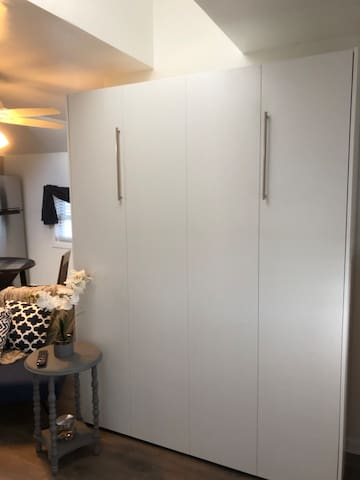 Queen size Murphy bed, closed allows for roomy living space.