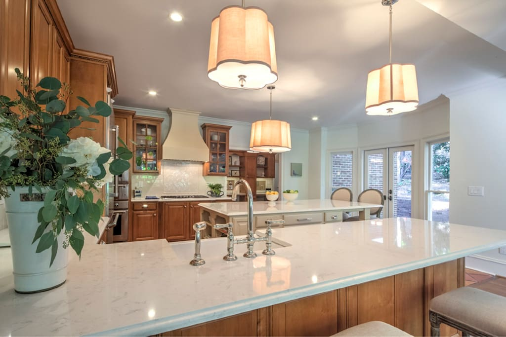 Beautiful sunlit kitchen completely renovated with new with all gourmet appliances - open to the family room and the terraces.