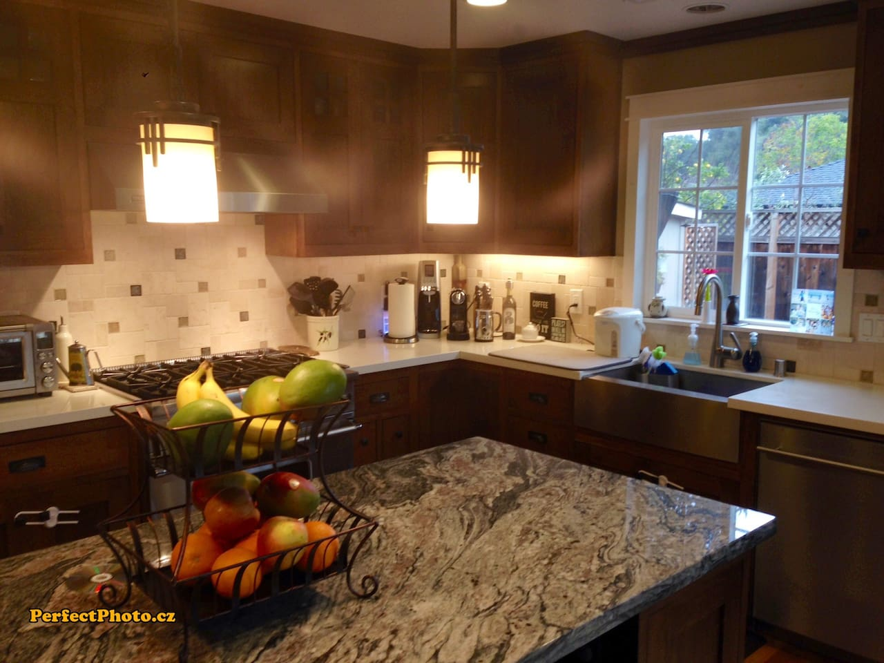 Open kitchen with large island (seats 4) and 6-burner chef's stove