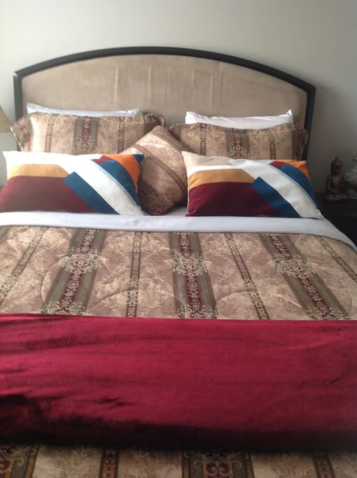 Queen size bed in Guest bedroom facing north west