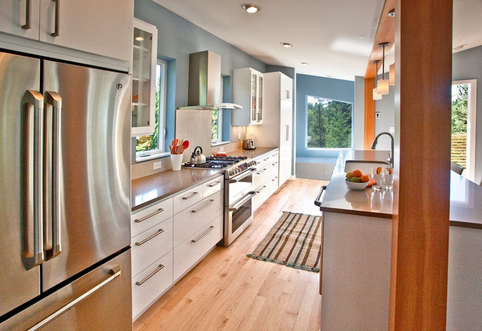 Organized and well-supplied kitchen with plenty of storage space for all your groceries.