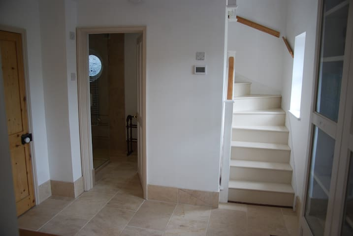 Entrance hall with shower room on left and stairs