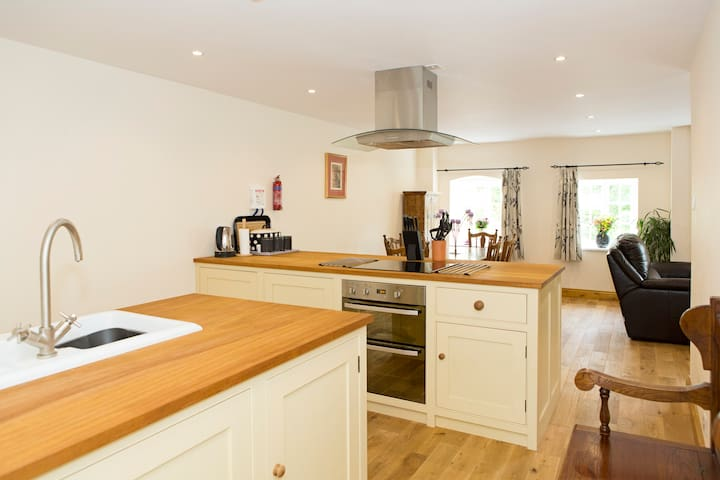 Bespoke hand-crafted kitchen is fully-equipped and stocked with basic provisions