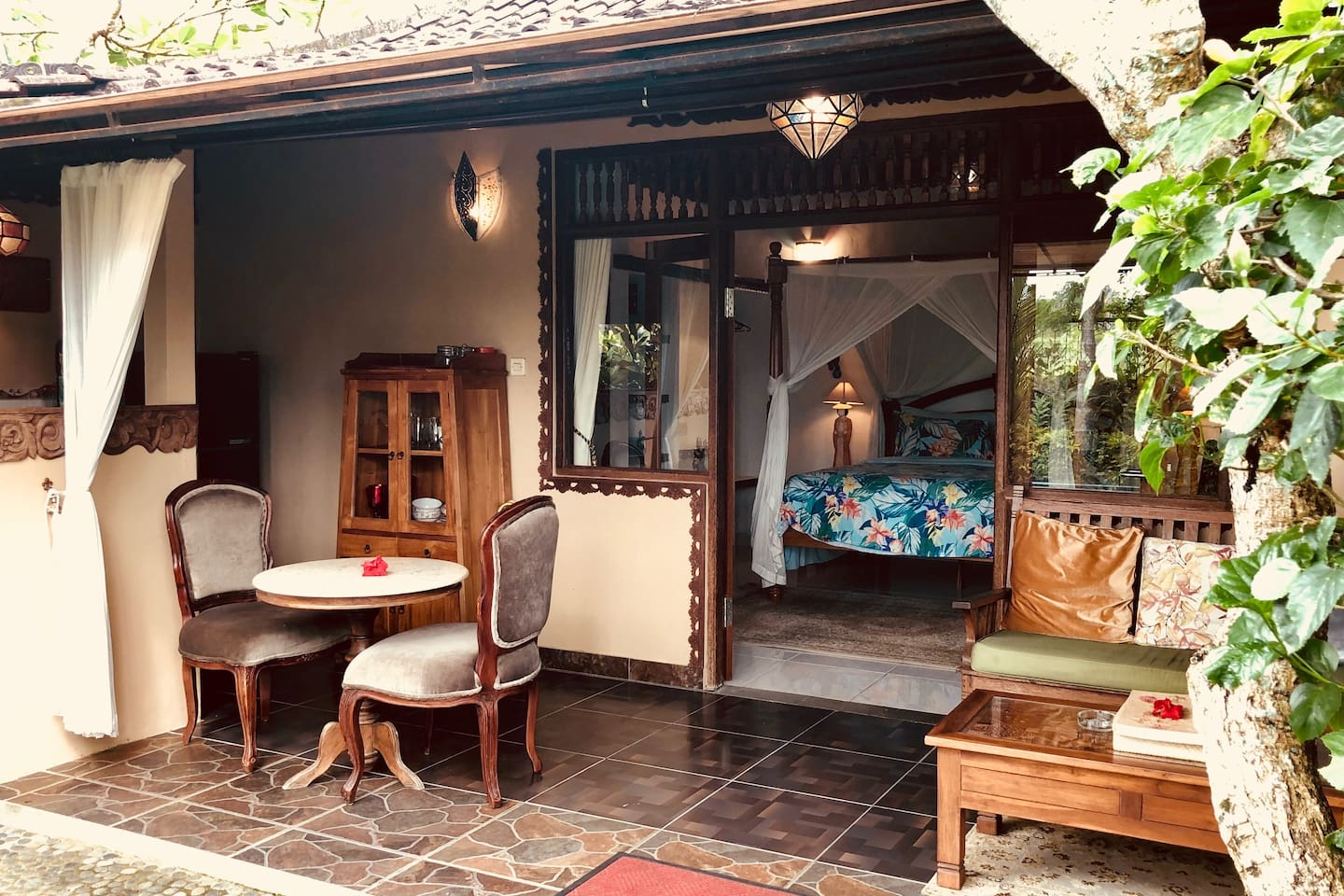 Jacaranda - a complete hideaway Bali  cottage with good wifi and a comfy bed - AC in the bedroom and an outdoor shower.  Peek of the rice fields and shared salt pool .