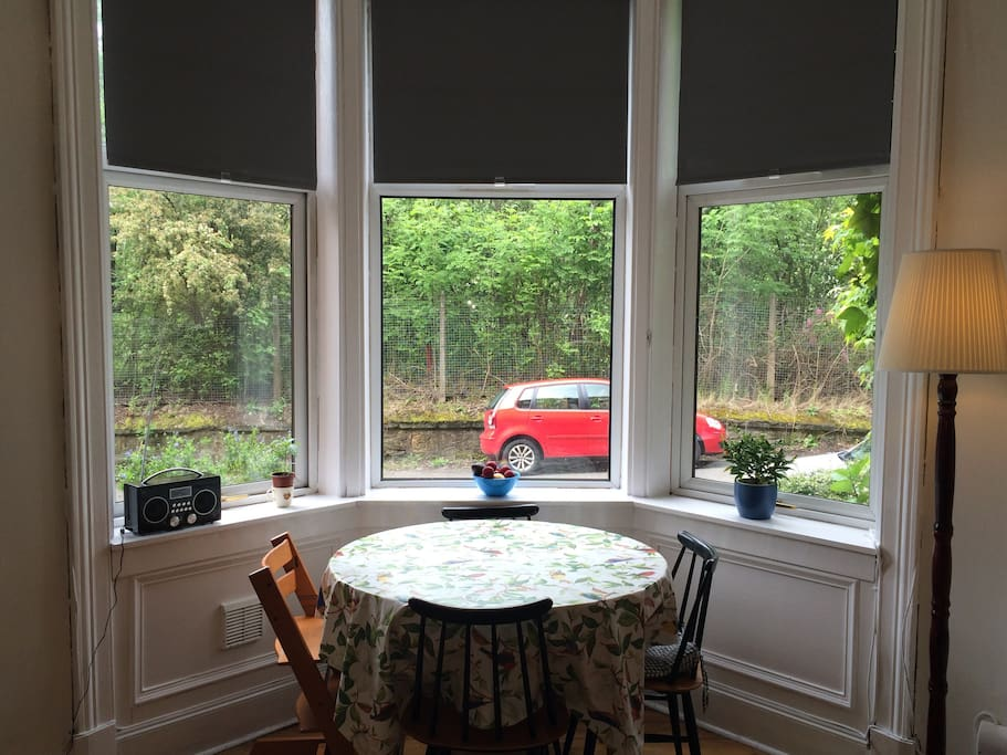 Bay window dining area with extendable table and 'Stokke' high chair