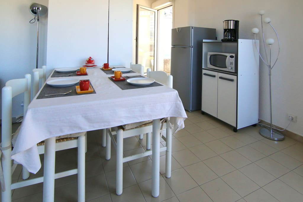 Dining table, fridge, microwawe oven...
