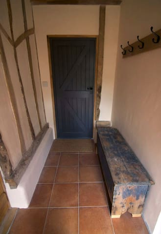Entrance hall has plenty of space for storing your wellies and jackets. There is also room for a push chair.