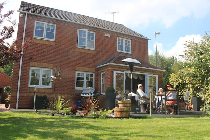 The rear garden. including lawn, patio and decking. Ideal for relaxing.