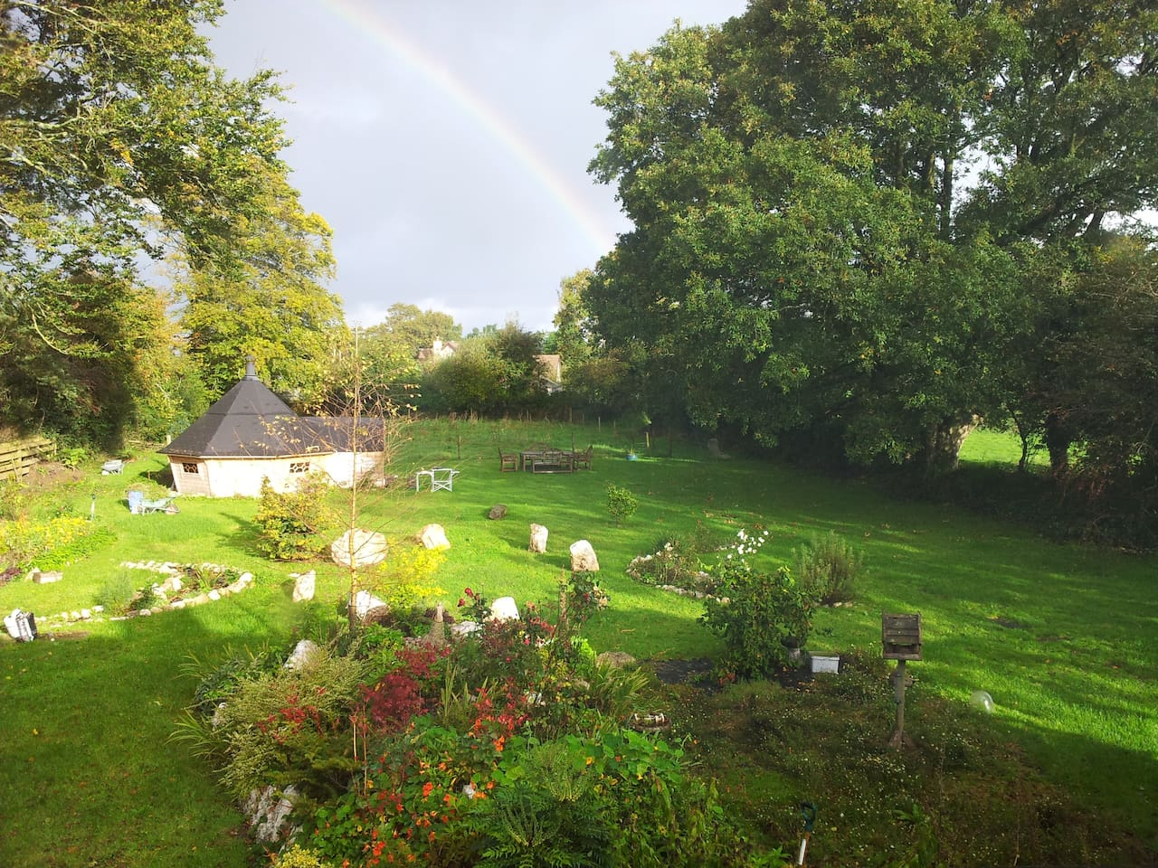 The Pixie House situated in an unusual evolving garden with a stone circle and moon garden.