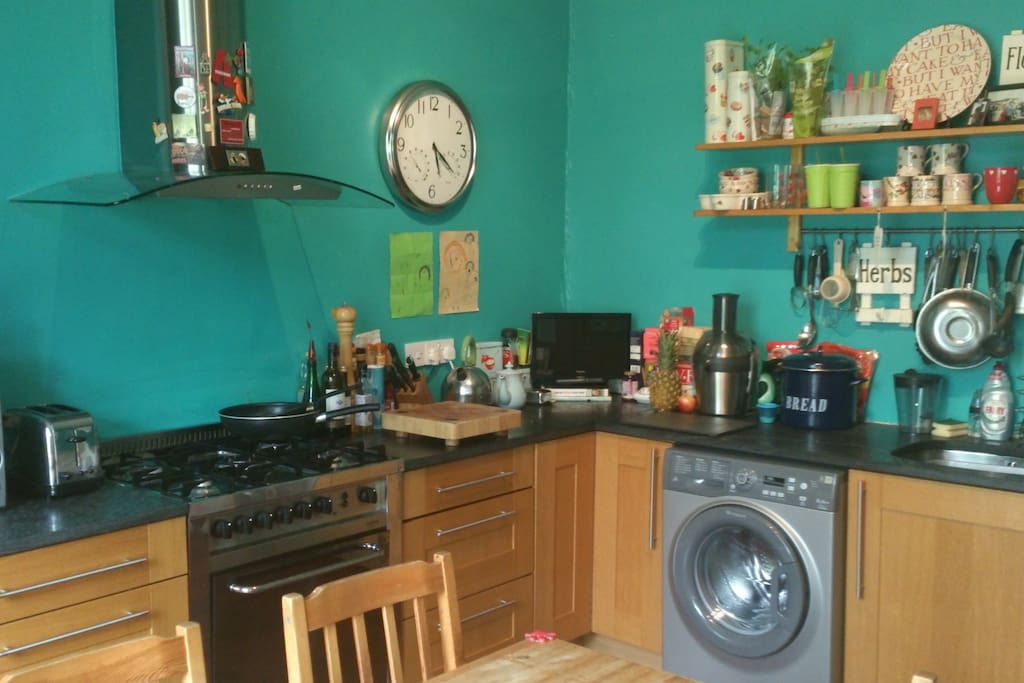 Spacious Kitchen with dining table.  Gas hob and oven, fridge, freezer, washing machine, dishwasher.  Lovely views to back garden.