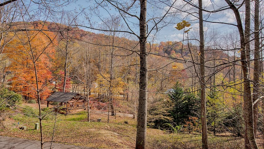 Fall view from front porch.  Pavilion,  fire-pit and creek just below the cabin.