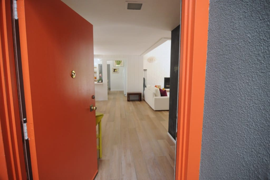 Grey exterior, blond Oak and white walls complemented by splashes of color.