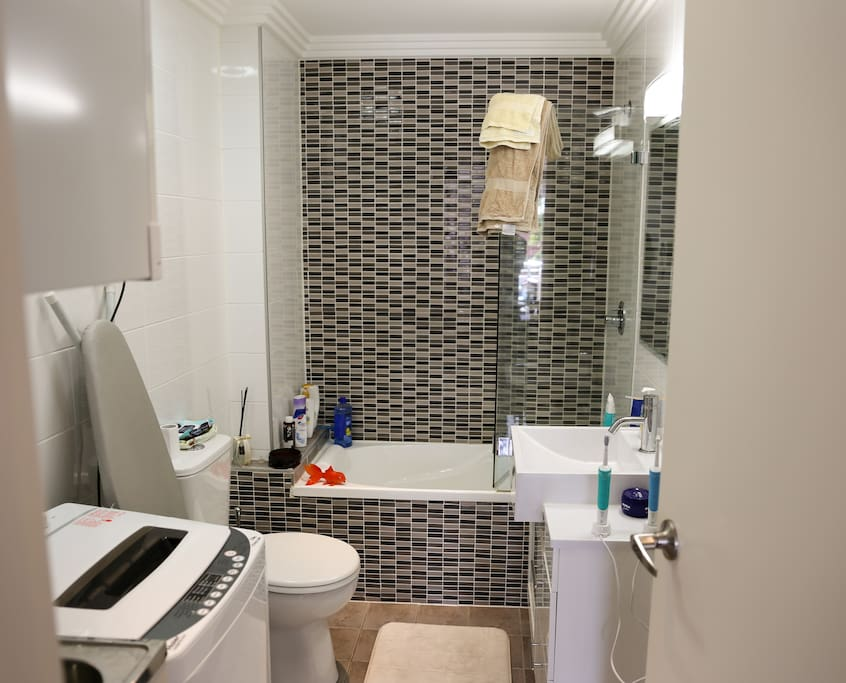 Bathroom with bath and washing machine/dryer...