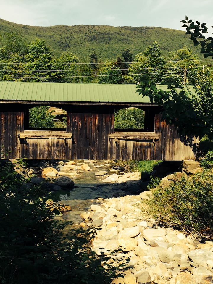 Enjoy the sight of a Vermont covered bridge and the sounds of the babbling Brewster River, right outside your apartment.